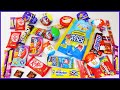 lots of candies and chocolates with kinderjoy surprise eggs opening